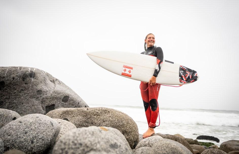 Bethany Zelasko holds her board