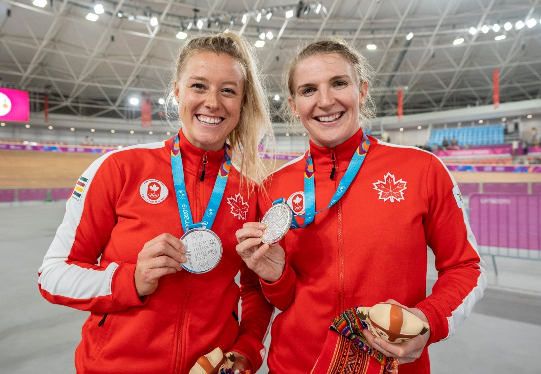 Kelsey Mitchell and Amelia Walsh with their silver medals in the women's team pursuit
