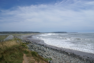 Beach spot with waves and rocky sand