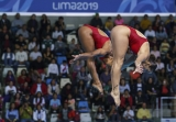 two divers in mid air
