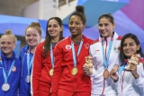 six divers on the podium with medals