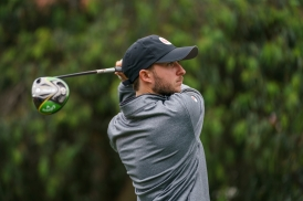 golfer finishes swing