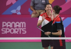 two badminton players high five