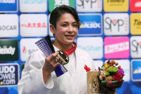 Christa Deguchi poses for a photo with her gold medal from the women's -57 kg weight class at the Judo World Championships