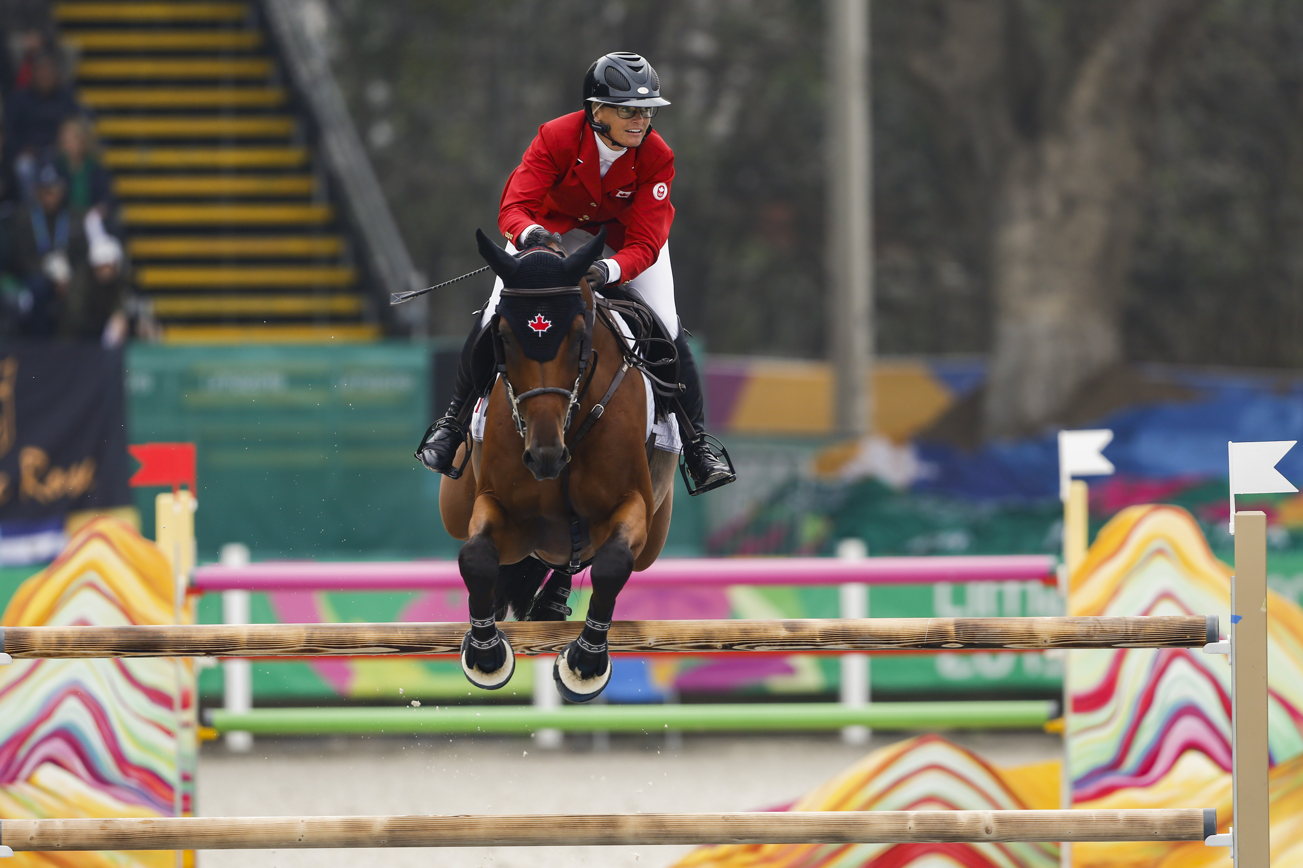 horse and rider jump over a jump