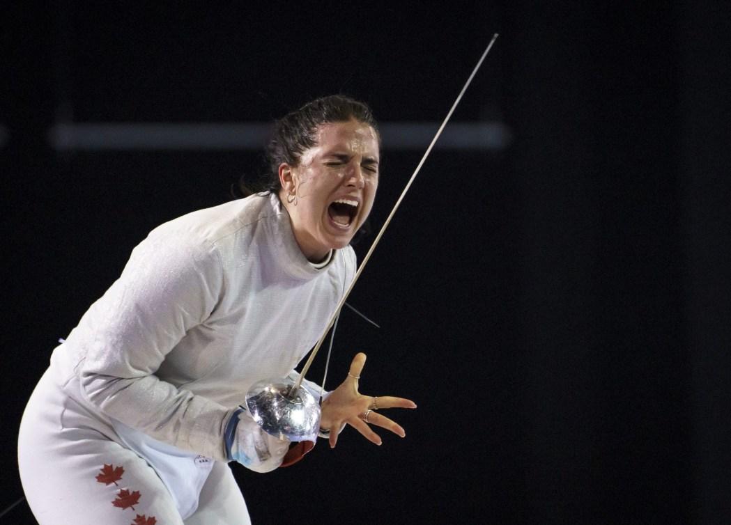 fencer celebrates