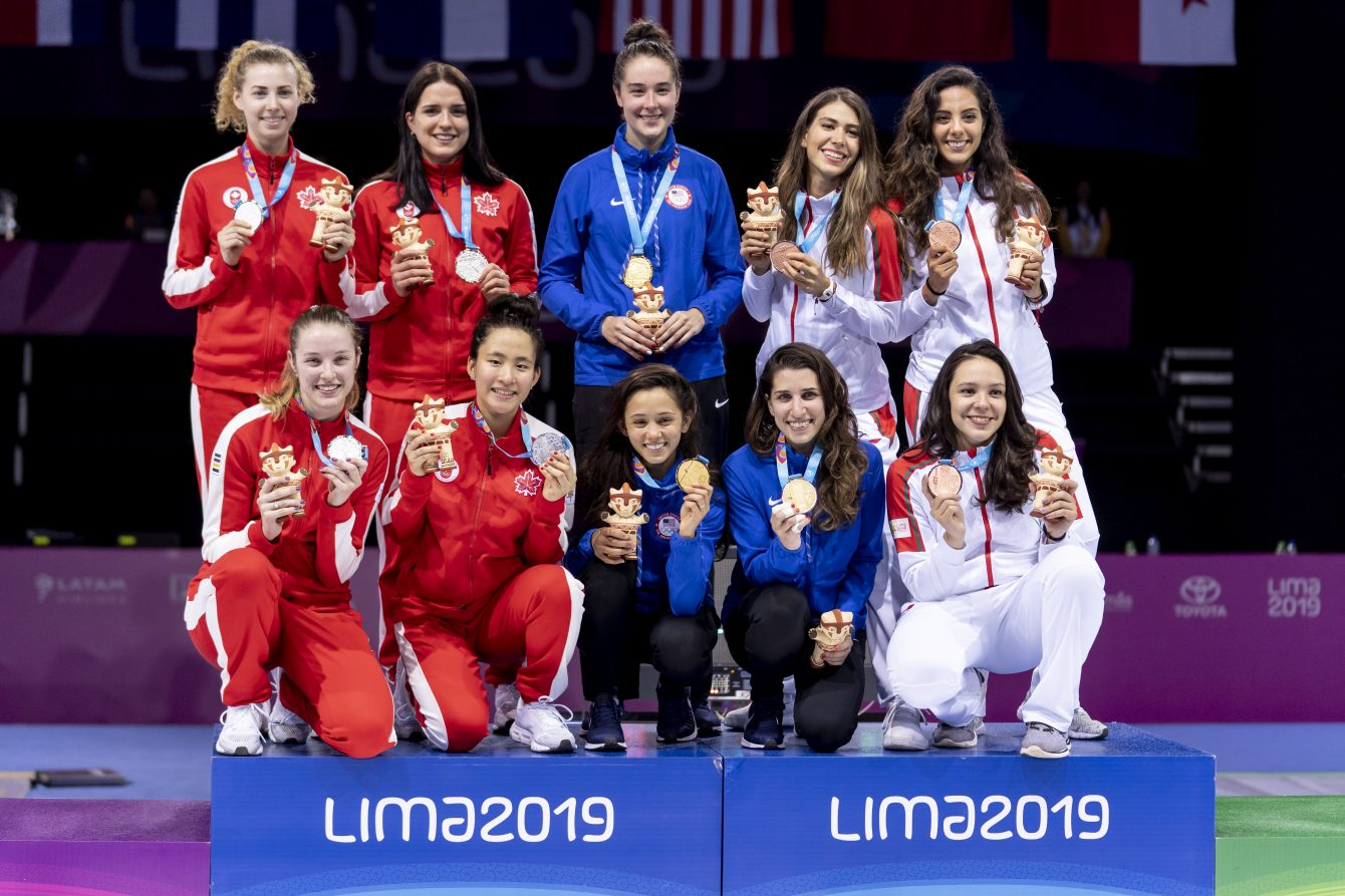 Women's foil team poses with silver medals