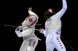 two fencers compete