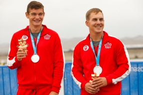 Jarret Kenke and Jacob Steele from Canada celebrate the silver medal