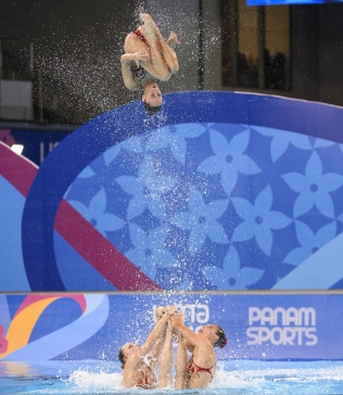 artistic swimmer flies in the air
