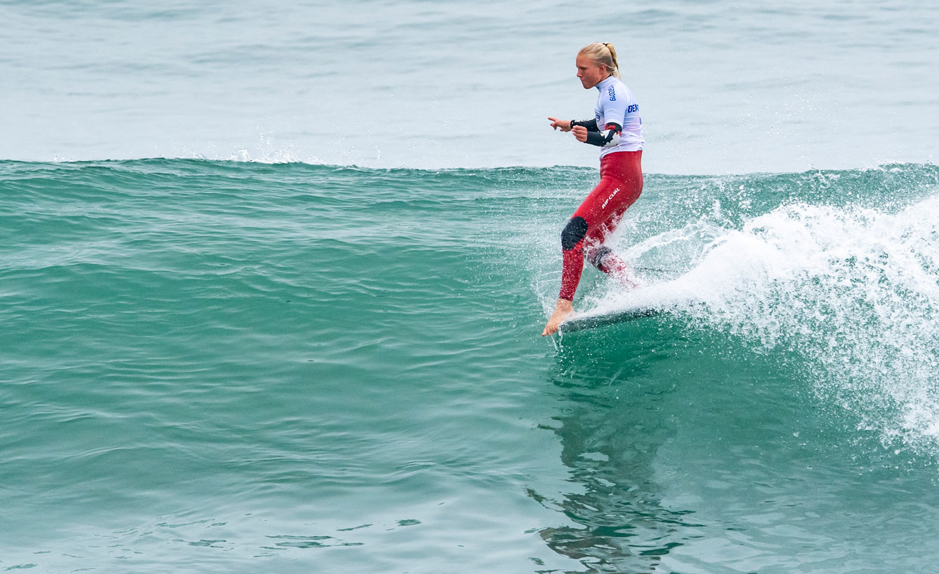 Mathea Olin competes in the women's longboard