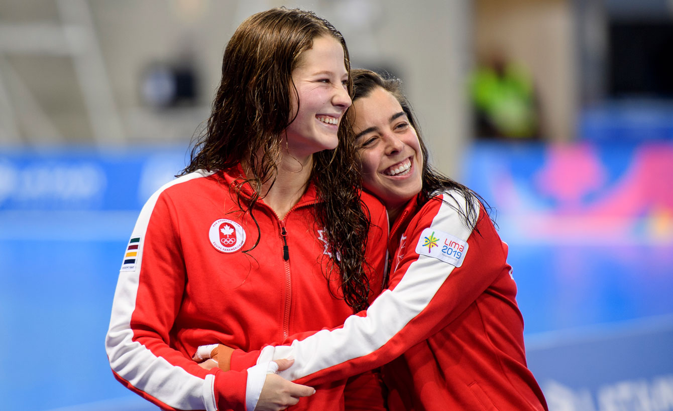Meaghan hugs Caeli after their gold medal at Lima 2019.