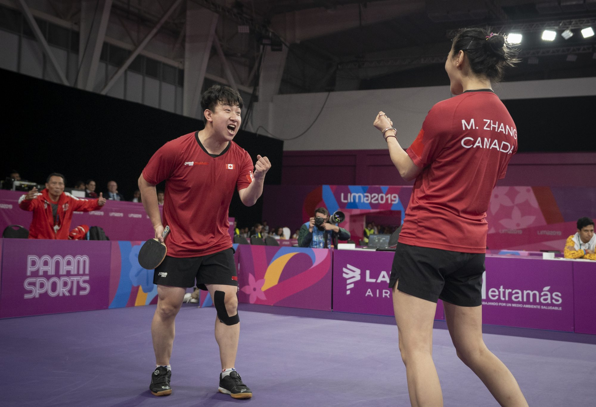 two athletes celebrate a win