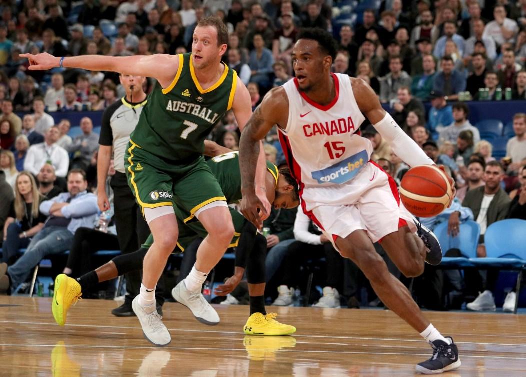 Canada's Oshae Brissett, right, drives past Joe Ingles, of Australia, during an exhibition basketball game in Perth, Australia.