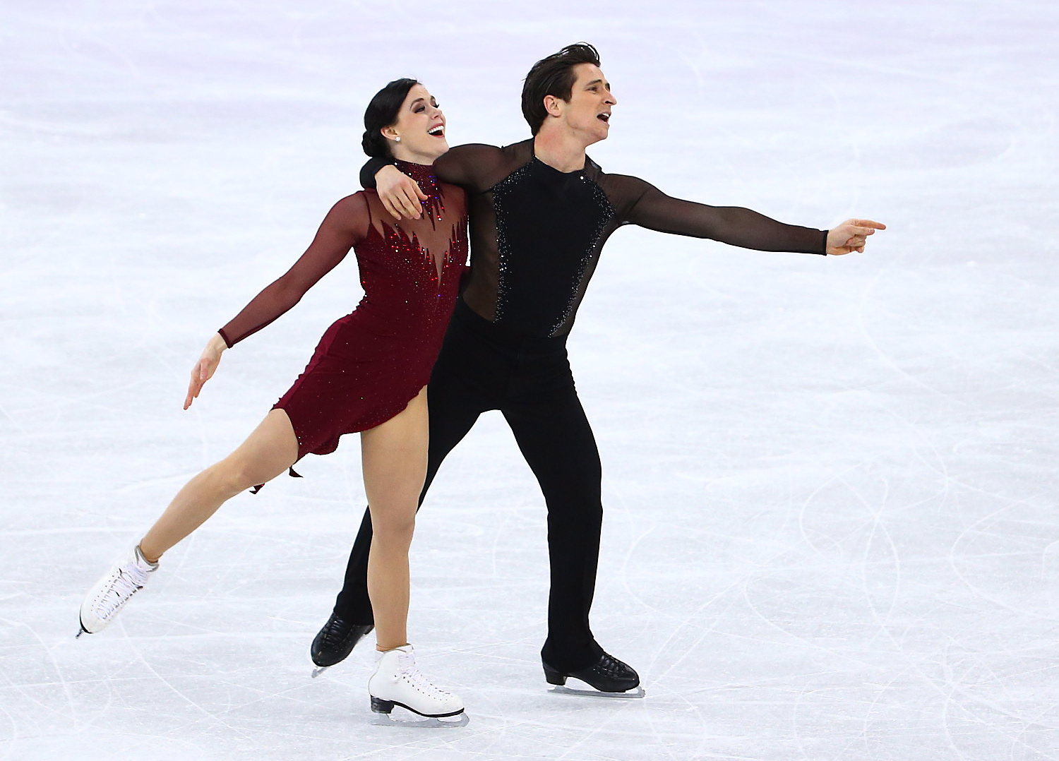 Tessa Virtue and Scott Moir skating during their gold medal Olympic performance.