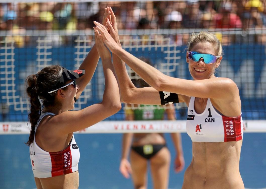 Melissa Humana-Paredes and Sarah Pavan celebrate