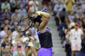 Bianca Andreescu, of Canada, reacts after defeating Elise Mertens