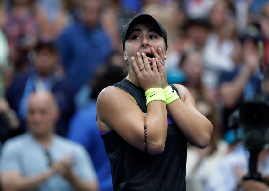 Bianca Andreescu, of Canada, reacts after defeating Serena Williams