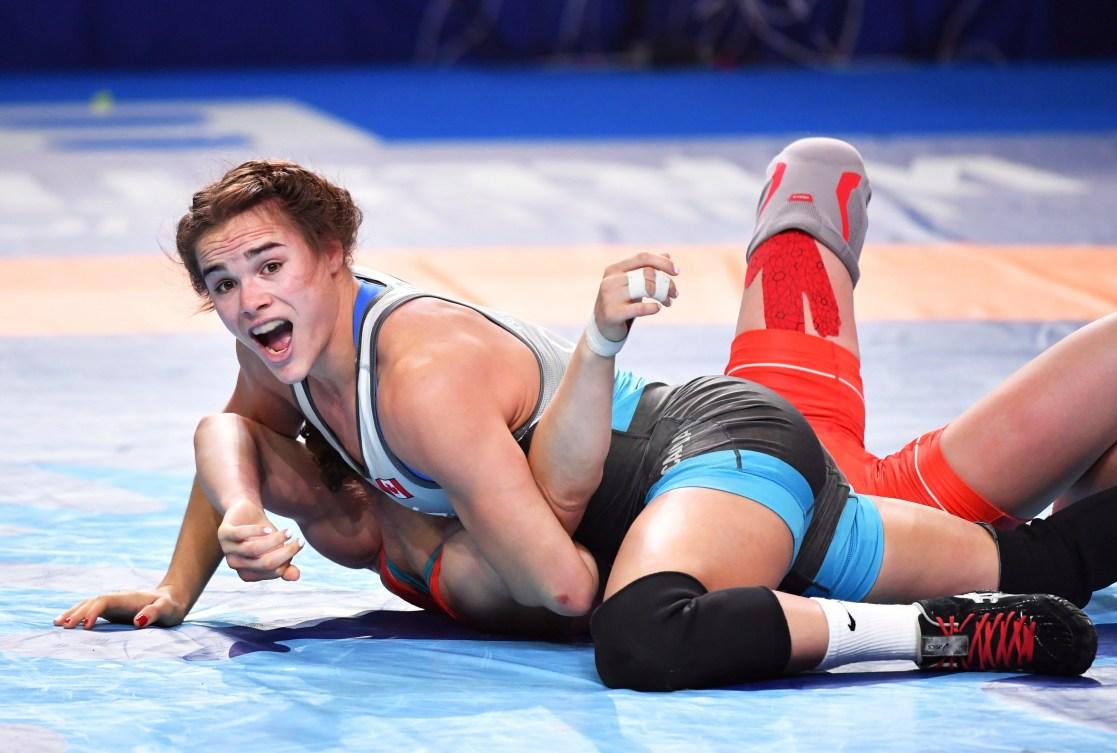 Linda Morais (left) pins Liubov Ovcharova down on the mat.