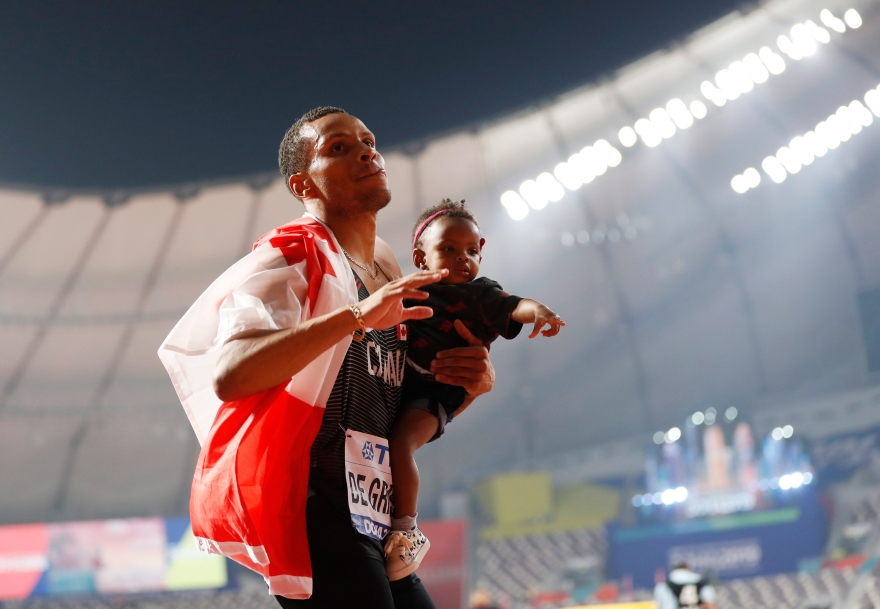 Andre de Grasse celebrating with his child