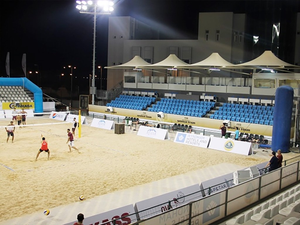Beach volleyball is taking place at the Al-Gharafa club in Doha