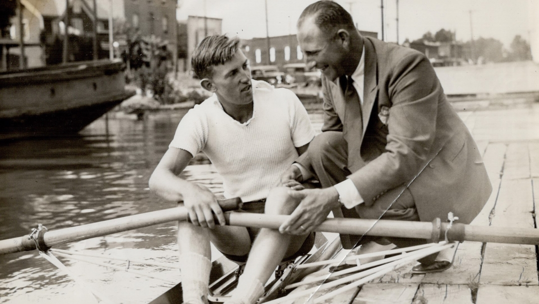 Bobby Pearce, right, speaking with a rower