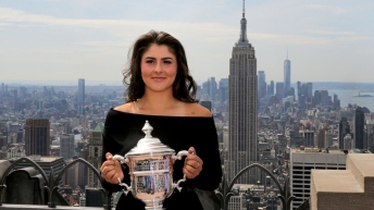 Bianca holds US Open Trophy in front of skyline