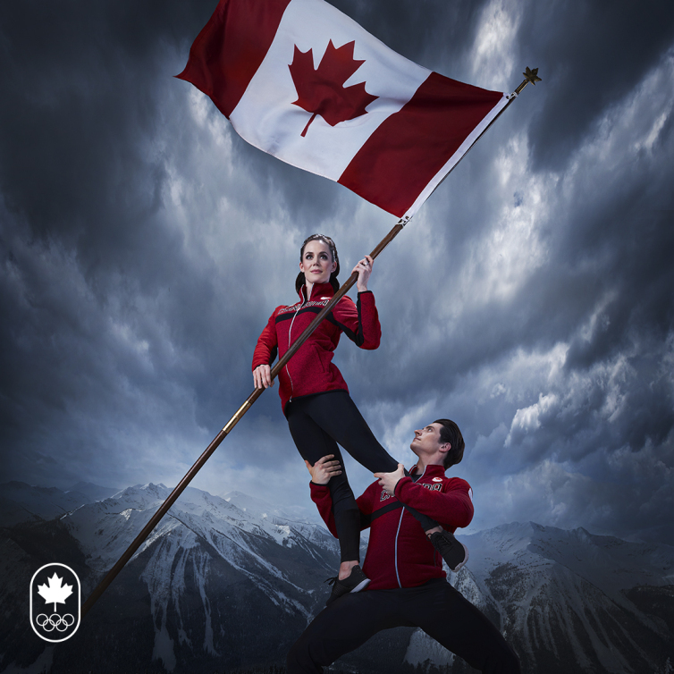 Tessa and Scott holding the Canadian flag for the torchbearer picture