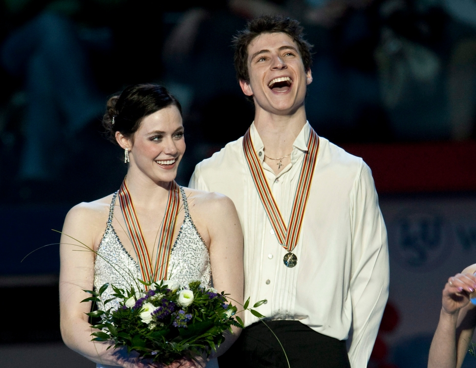 Tess and Scott smiling after receiving their medals