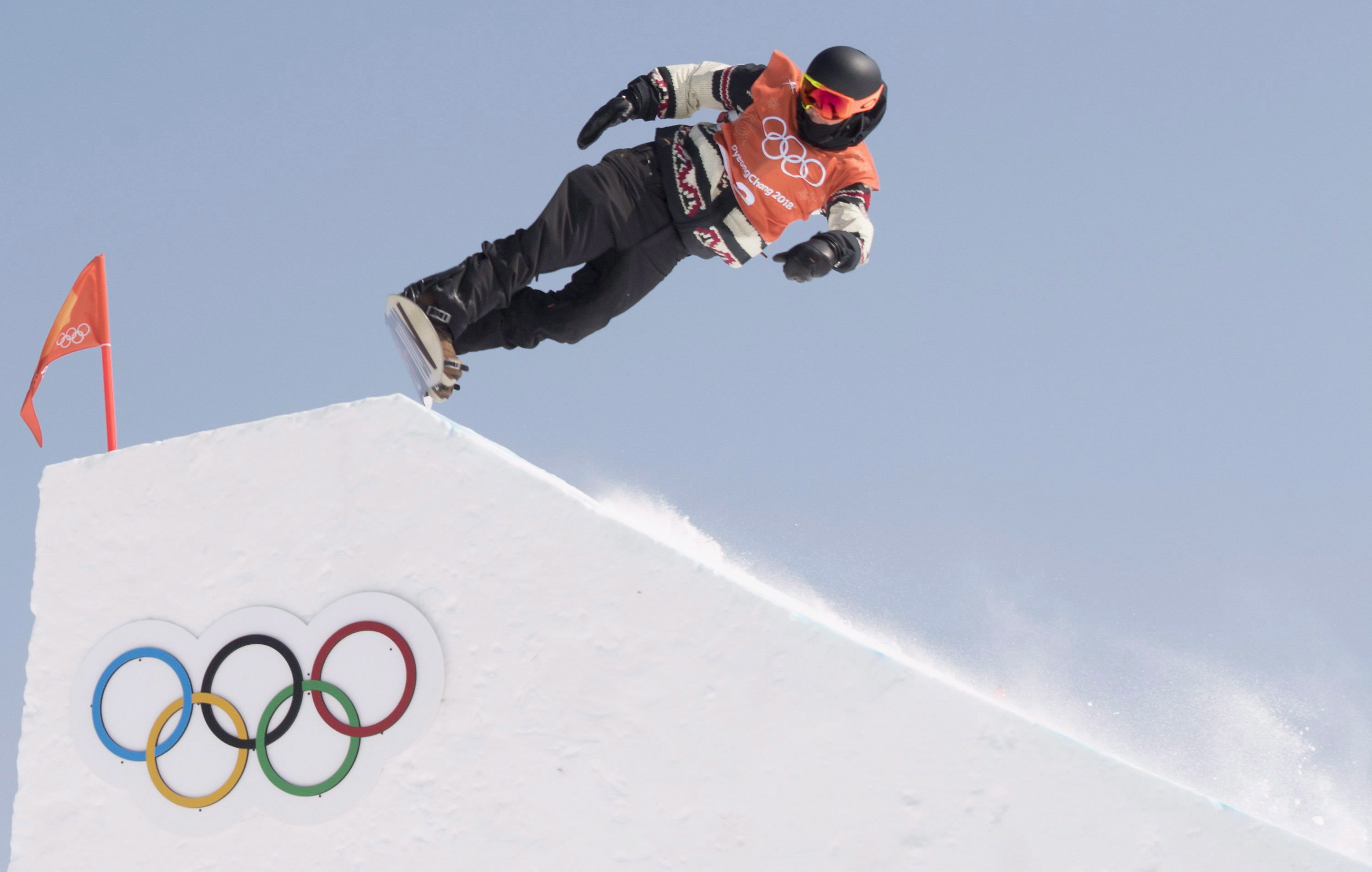 Mark McMorris about to snowboard down a hill at the Pyeong Chang Olympics.
