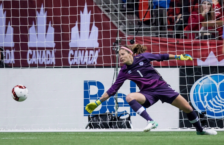 Goalkeeper Stephanie Labbé stretches out to dive for a shot coming her way.