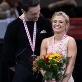 Kirsten Moore-Towers and Michael Marinaro share a laugh during victory ceremonies