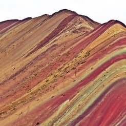 Mountains adorned with red, yellow, and green colours.