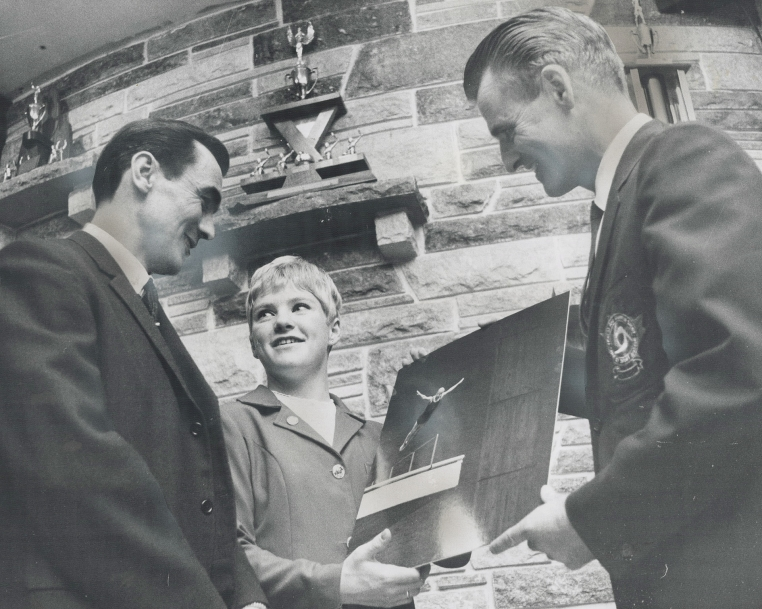 Beverly Boys (middle) is honored with a photograph of her dive at the 1968 Mexico Summer Olympics