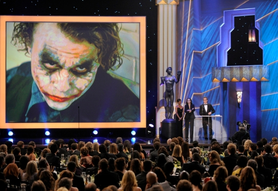 Gary Oldman accepts an award for Heath Ledger