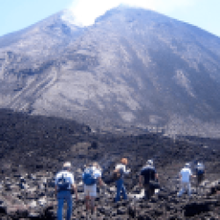 Hikers walking towards the volcano.