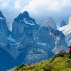 Scenic view of hikers with the mountains in the back.