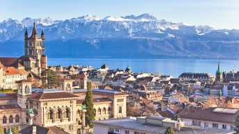 Scenic view of the city of Lausanne, with mountains in background.
