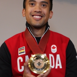 Gilmore Junio poses with his medal
