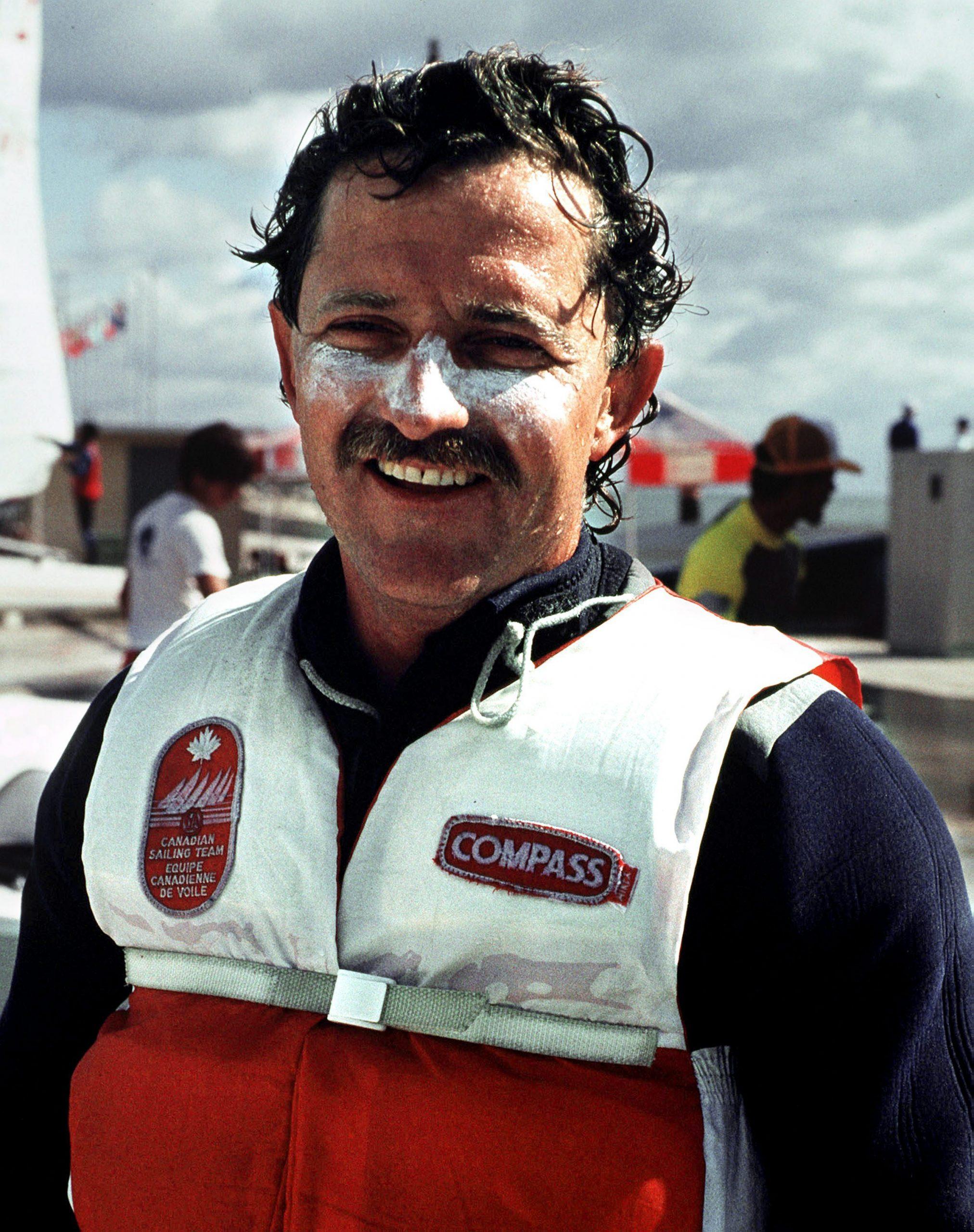 Lawrence Lemieux smiling while wearing his life jacket