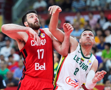 Owen Klassen battles for position with Lithuanian player