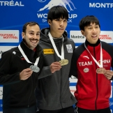 steven dubois on the podium posing with his silver medal alongside the gold and bronze medal