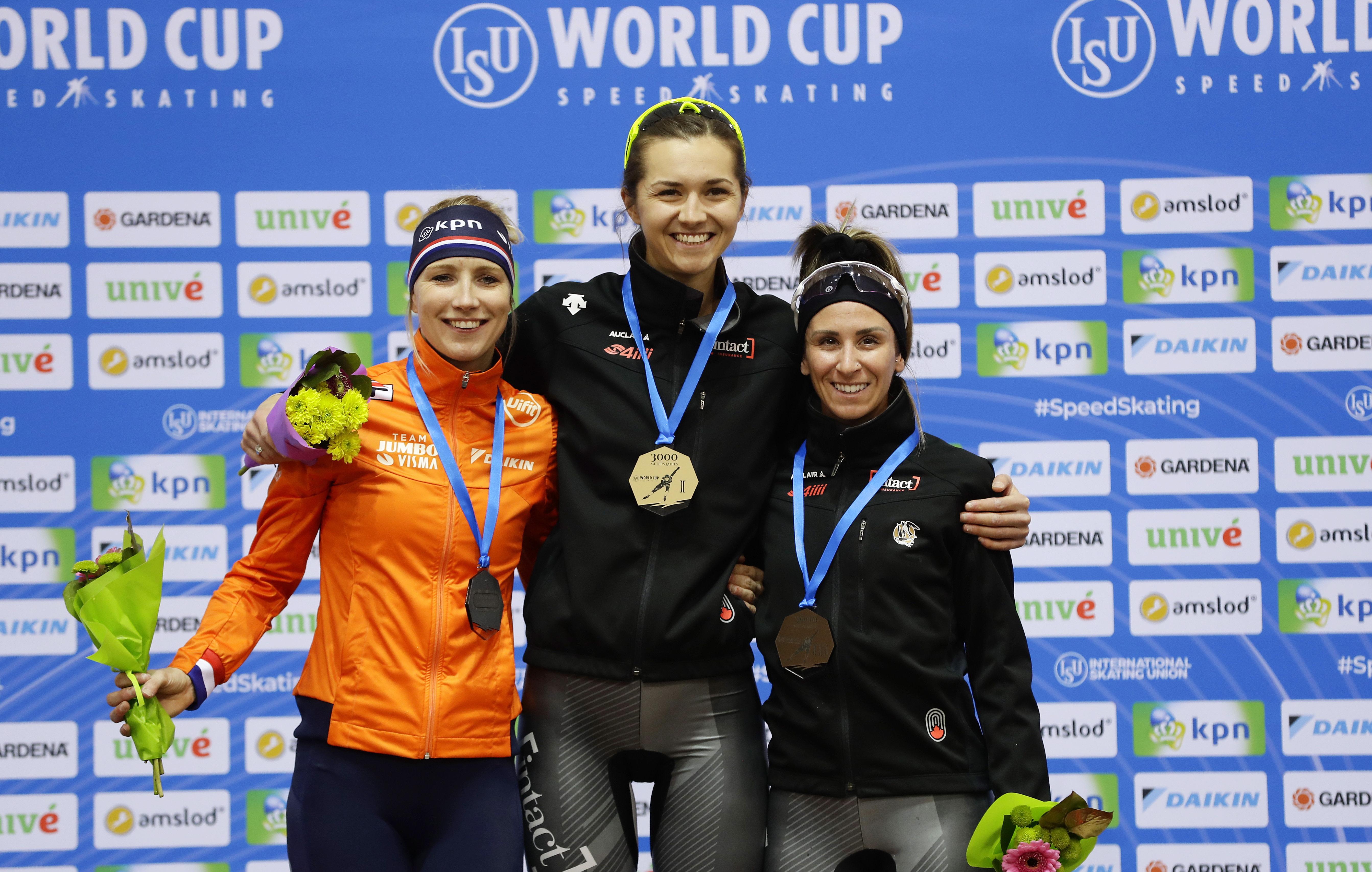 Speed skating medal winners on podium