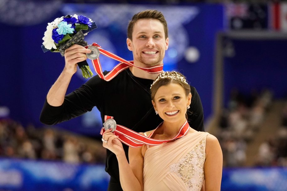 Silver medalists Kirsten Moore-Towers and Michael Marinaro of Canada pose with their medals at a victory ceremony for the pairs free skating program during the ISU Grand Prix of Figure Skating