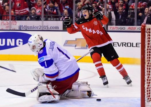 Team Canada's Sam Reinhart celebrates a goal