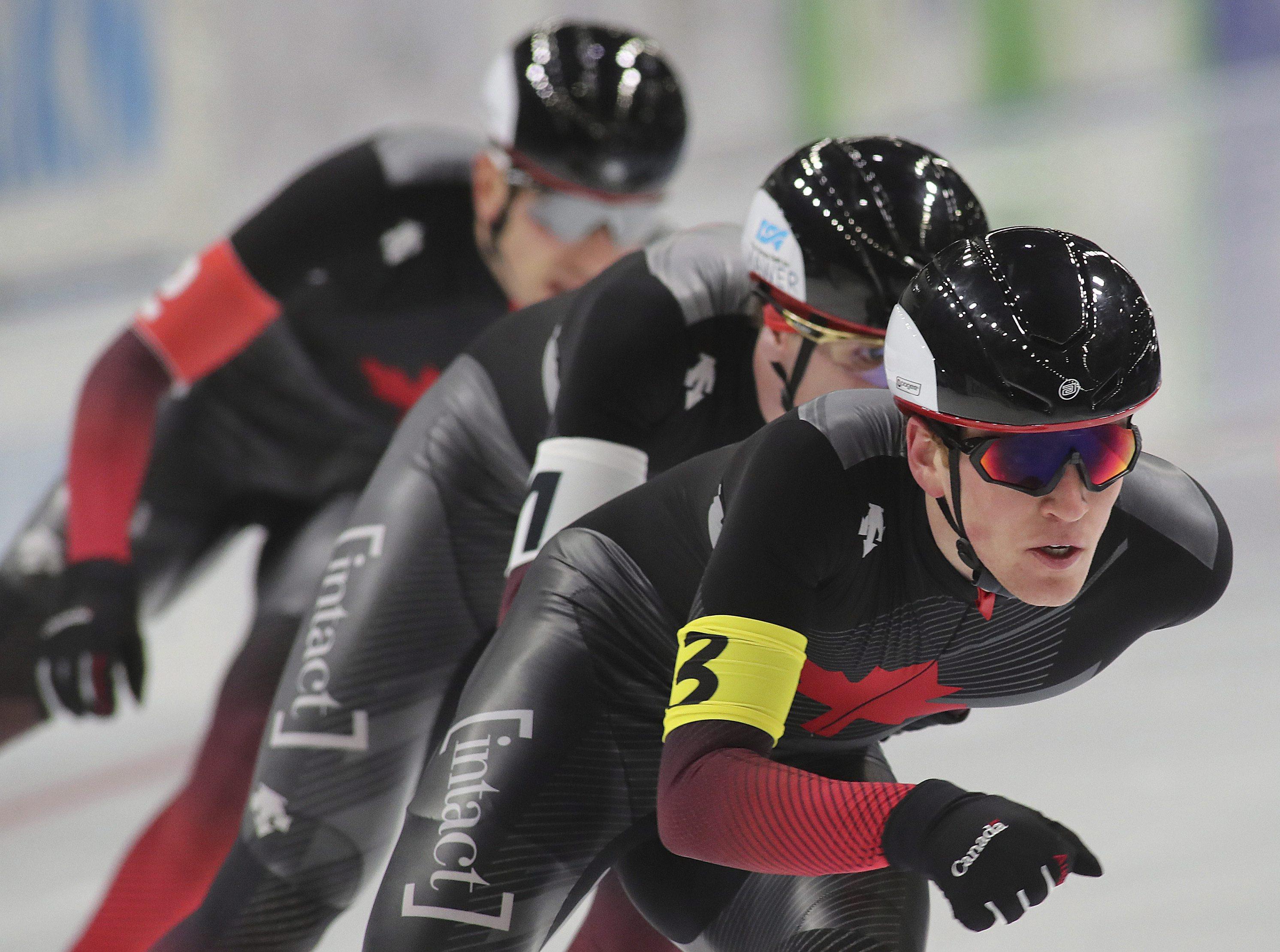 Canada's team in action during the men's team race of ISU Speedskating World Cup in Tomaszow Mazowiecki, Poland, Sunday , Nov. 24, 2019. (AP Photo/Marian Zubrzycki)