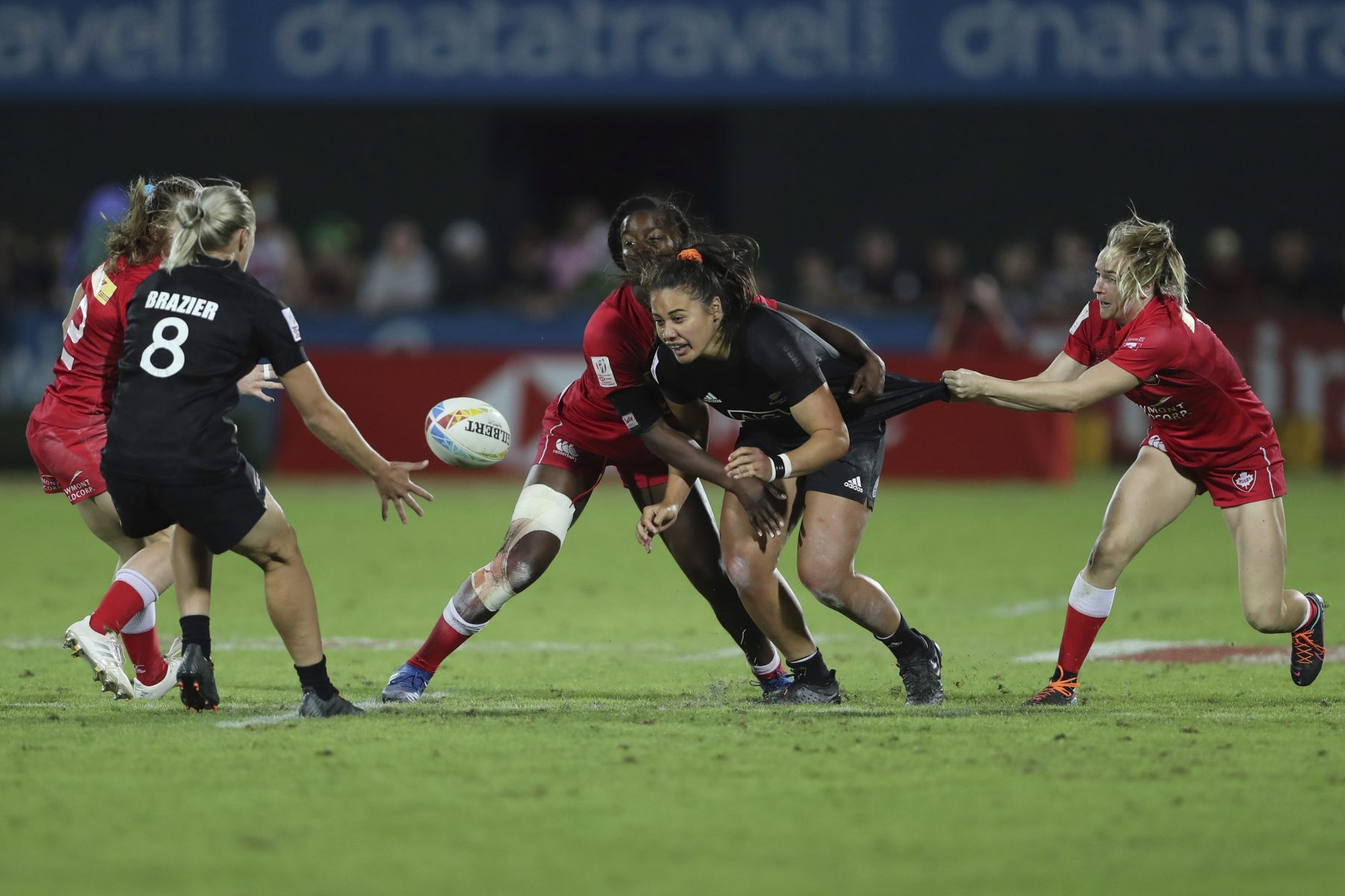 New Zealand's Shakira Baker passes the ball in the final match against Canada at the Emirates Airline Rugby Sevens in Dubai, United Arab Emirates, Saturday, Dec.7, 2019. (AP Photo/Kamran Jebreili)