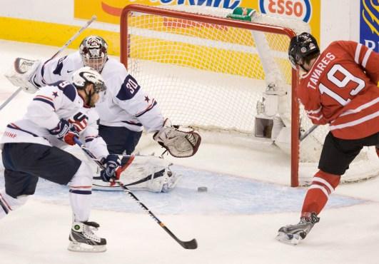 Team Canada's John Tavares fires the puck