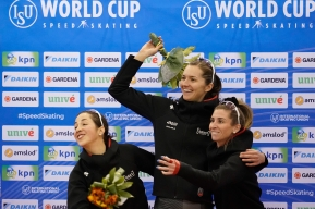 (L-R) Valerie, Isabelle and Ivanie on the podium, laughing at something to the left.