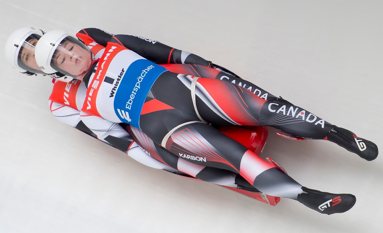 Caitlin Nash and Natalie Corless slide down the track at Whistler.